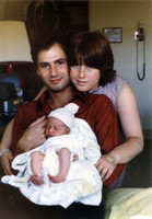 My parents and I the day I was born.