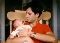 Me, the newborn, with my dad.