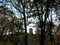 Inwood Hill Park: a view of the Cloisters museum through the trees.