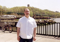 Me, at Tubby Hook on Dyckman Street with the Cloisters and Hudson River in the background.
