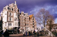 """Amsterdam, a rare moment of incomplete cloud cover. Dave bought cheese to bring home at the shop in the bottom-left corner, but it was too stinky, so it """"fell"""" out of our hostel window."""