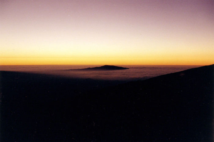 The sun sets over the Big Island. This picture was taken from near the top of Mauna Kea.