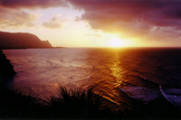 """Gorgeous Kaua'i sunset. The silhouetted cliff on the left side was featured in the movie """"South Pacific"""" as Bali Hai, not its real name."""