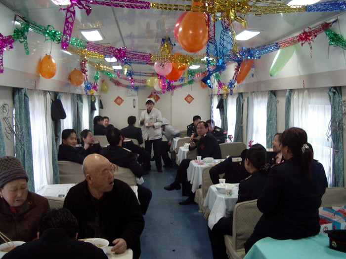 New Year's morning party in the dining car. Mostly train staff, but they were happy to give me a traditional New Year's breakfast of dumpling soup.
