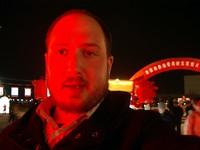 Self-portrait in the red glow of a huge lantern.