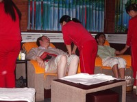 We all went to get foot massages after celebrating Small David's birthday. The team of masseuses in red jumpsuits did a pretty good job. Big David and Lincoln look like they're enjoying themselves, no?