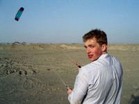 William flies his wind-surfing kite way, way, way on the outskirts of Korla. I also gave it a try.