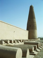 Looking at the minaret from behind the Emin Ta mosque. Those are graves in the foreground.