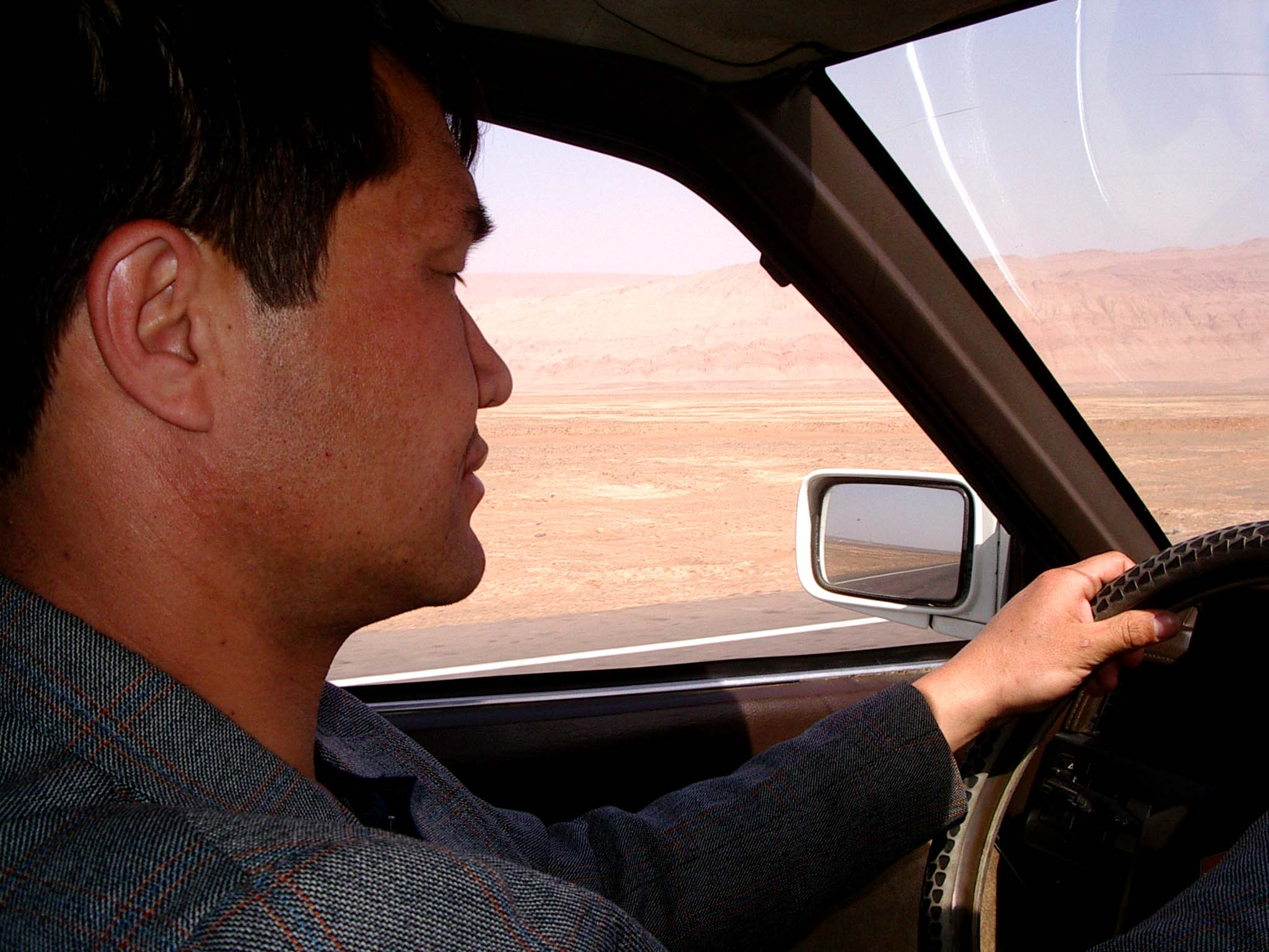 Our Uyghur guide and driver, Parhat, on the road to Gaochang.