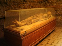 A wider view of a mummy at Astana.