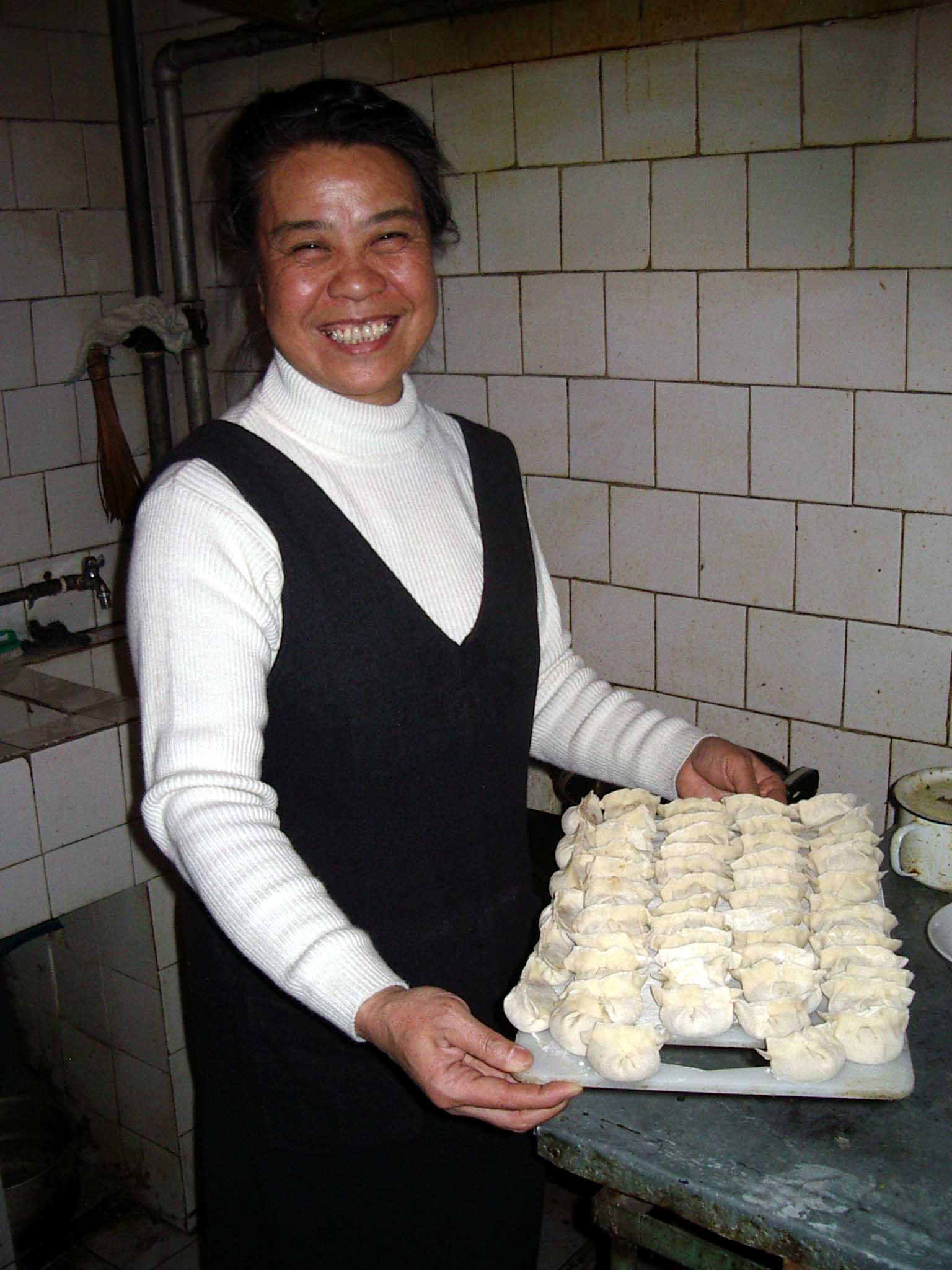 Wang Laoshi, a good friend and the proprietor of Korla's finest tea house, shows off her dumpling skills.