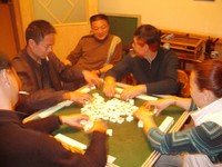 The usual suspects gather for a smoky evening of Mahjong at the tea house.