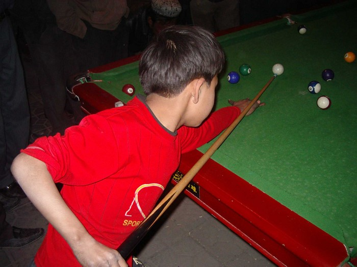 My little friend from the Uyghur pool hall strikes a pose.