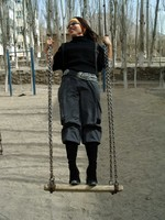 Tian Ping (who is also Wang Laoshi's daughter) enjoys a swing ride before our ascent of Tiemenguan
