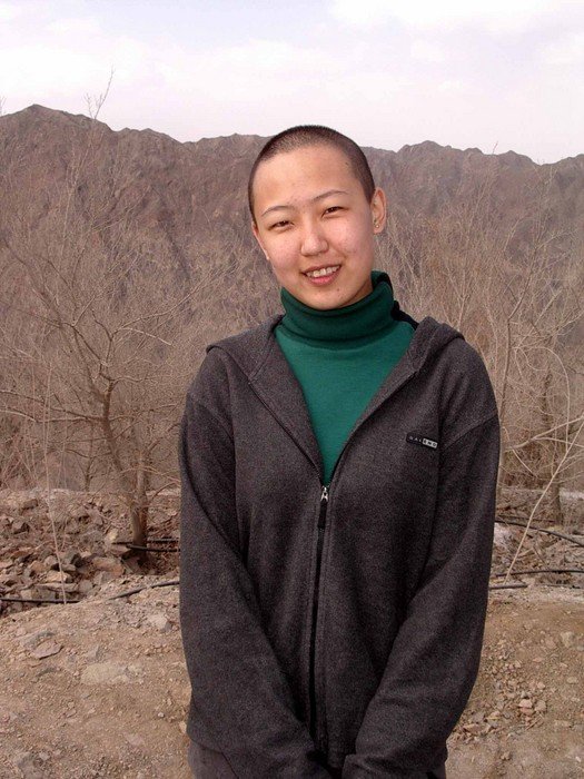 Liu Xin, only days after cutting off all of her hair. Now it's longer.