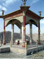 These graves are part of a famous Uyghur story. A long time ago, there was a princess, Tzuohla, who loved a simple shepherd, Tayir, much to her father's dismay. Her father, the king, arranged for her to marry a prince, so she ran off on a horse with her lover. The king sent troops to pursue them, and while crossing over these mountains they fell to their deaths.