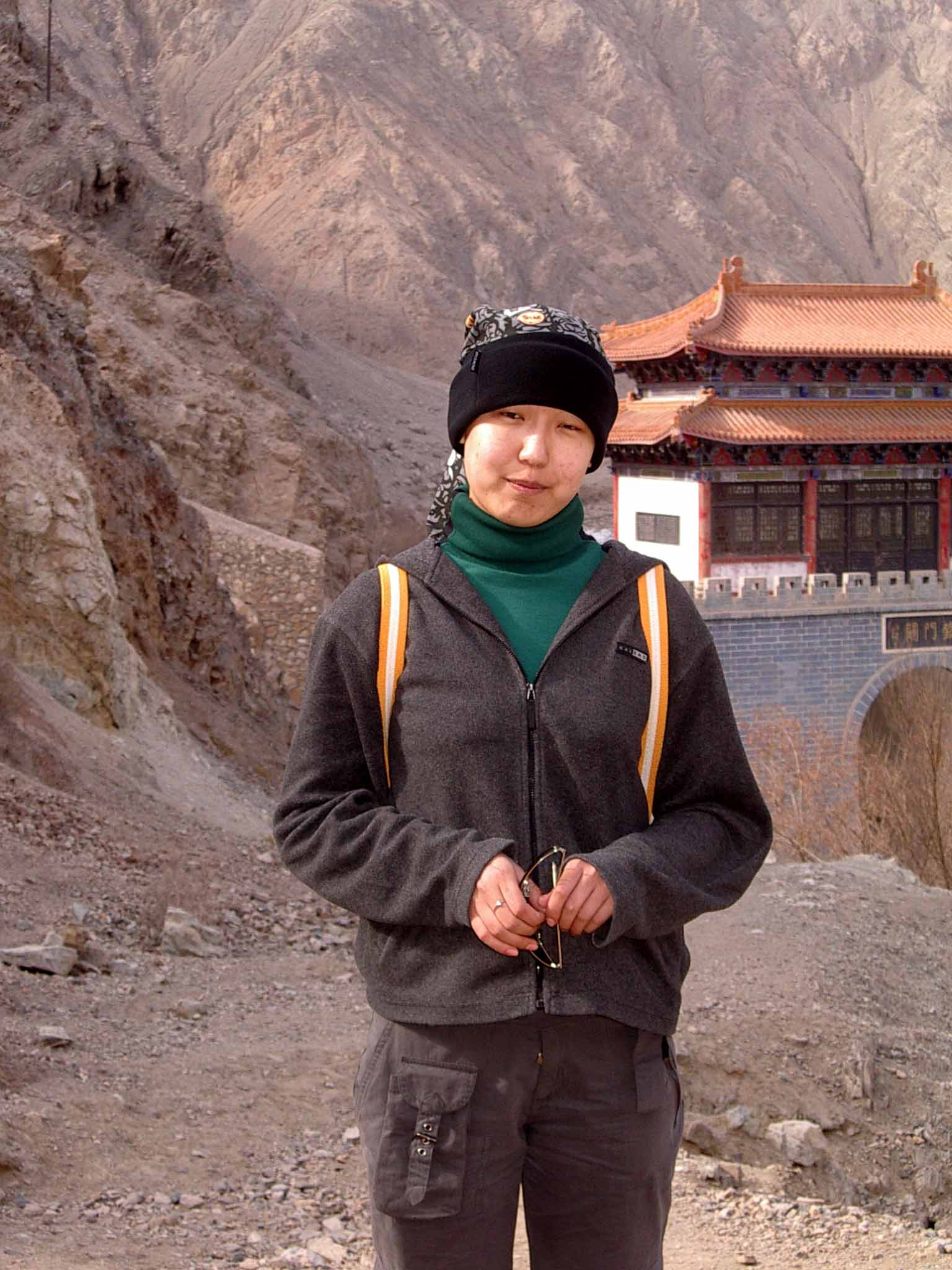 Liu Xin in front of the Iron Gate.