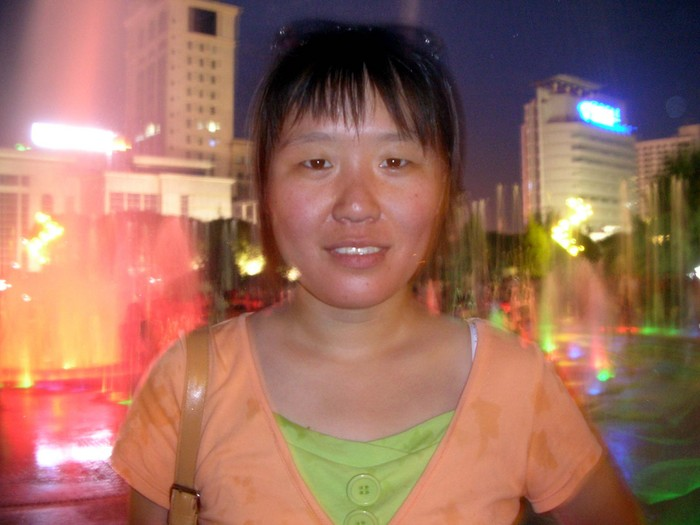 Wang Shan, one of Circle English's administrative staffers and an all-around nice girl, in front of the fountain.