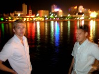 William (left) and Small David (right) pose for an eerie night-shot along the banks of the Kong Que River in downtown Korla.