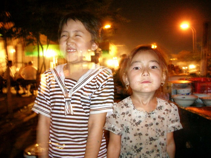 Once I'd taken a picture of her father, my friend's daughter (left) wanted to have her picture taken, too. Why can't kids stay still for 3 seconds? Cute little Uyghur girls, though.