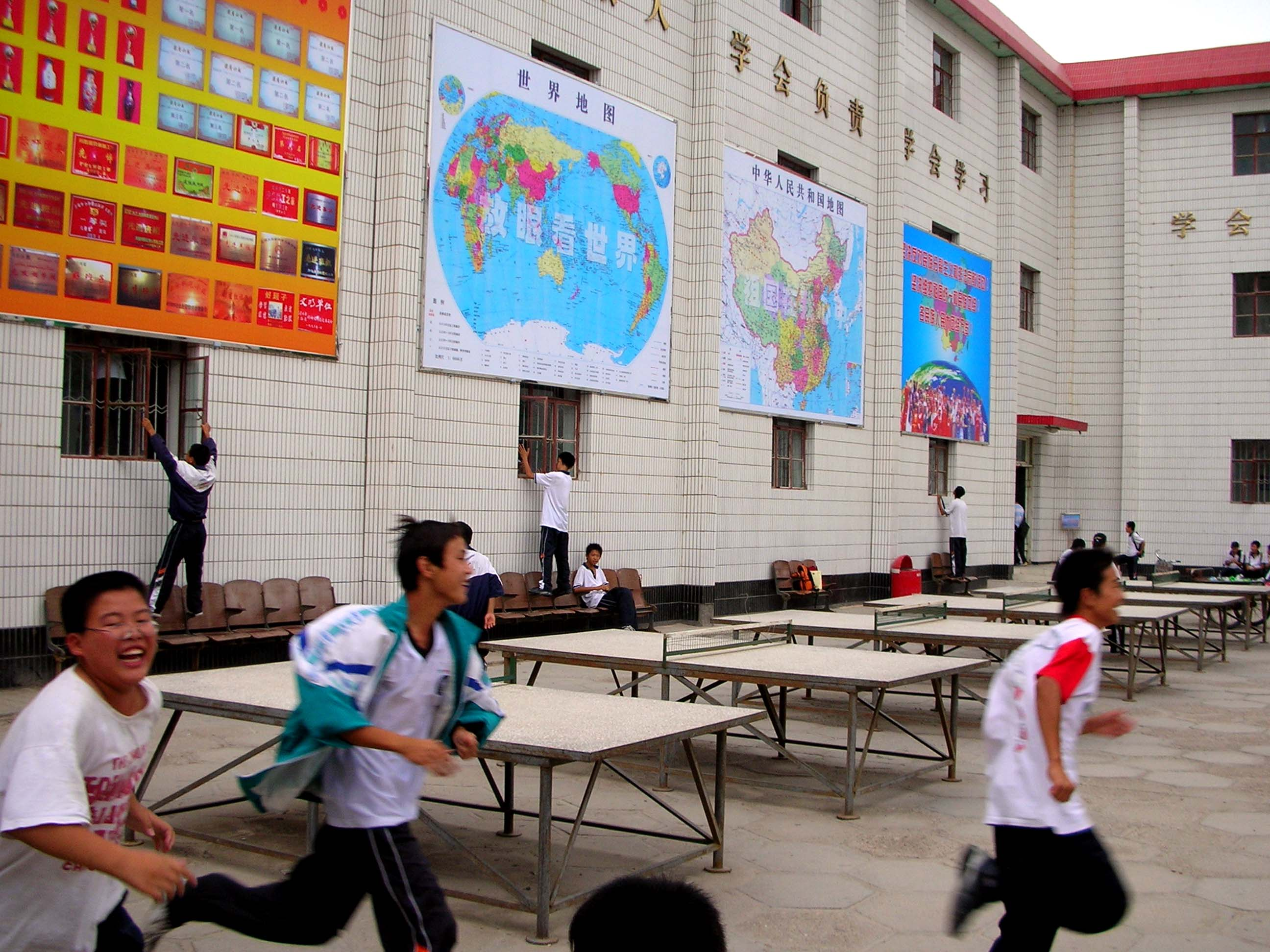 Yipeeeee! Students let loose at the end of the day. (Those are cement ping-pong tables behind them, by the way.)
