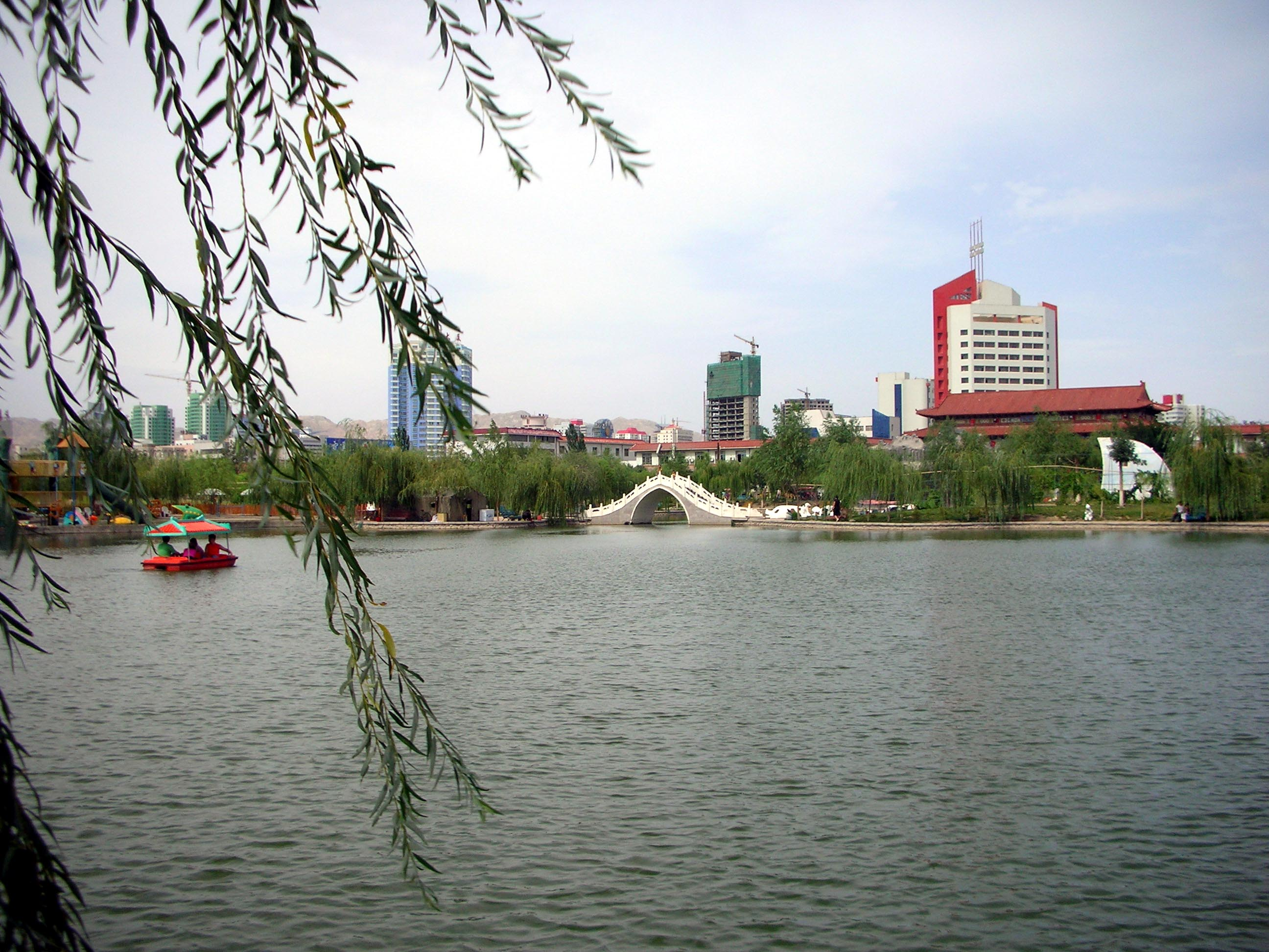 Looking towards the city center from the lake in Peacock Park.
