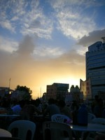 Watching the sunset while eating spicy barbecued vegetables at the night market.