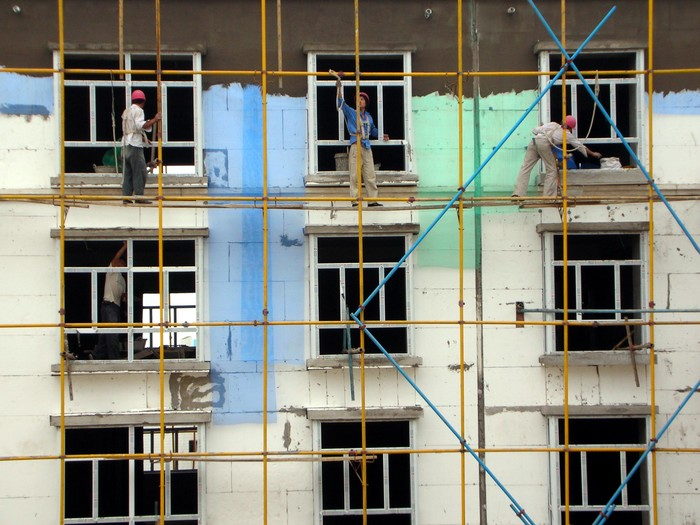 Construction workers in China are pretty nuts. The scaffolding is almost nonexistent, and they shimmy up and down the poles with only a rope tied around their waists. They've almost finished the new apartment building behind my new place.
