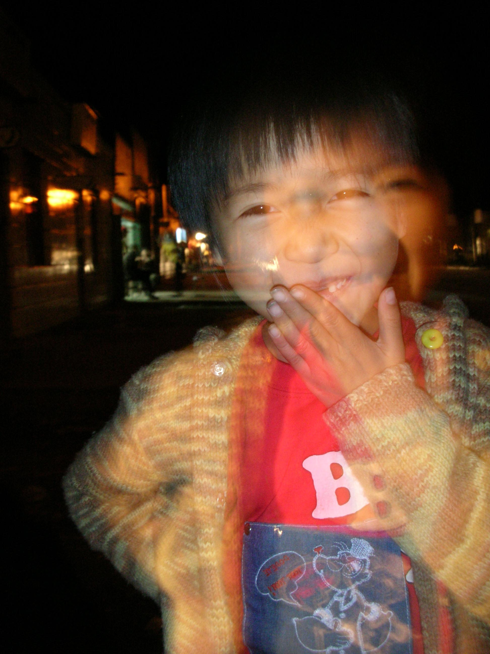"The daughter of the restaurant owner I stayed with in Hongqi. She couldn't stand still long enough for a clear shot. I happen to like this ""night portrait"" effect, however."