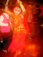 A young girl, well-trained at Uyghur dancing, rules the dance floor.