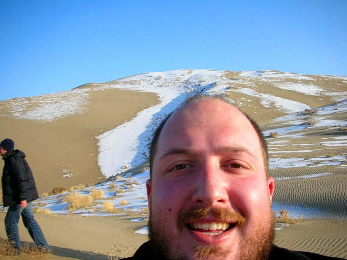Self-portrait while ascending the dunes beside Bosten Lake.