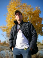 My Qu�b�cois roomate, Dominic Gagnon, power poses in front of a golden poplar.