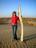 Camilla poses atop a sand dune with her proposed sand-sled. It didn't work.