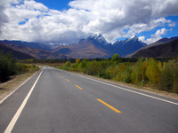 Heading west out of Lhasa, with the twin peaks of Karachowo and Karchomo in the distance. (They represent a husband and wife in some Tibetan story.)