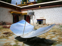 With the sun as powerful as it is in Tibet, a parabolic reflector has no problem bringing a kettle to a boil. Norbulingka Summer Palace, Lhasa.