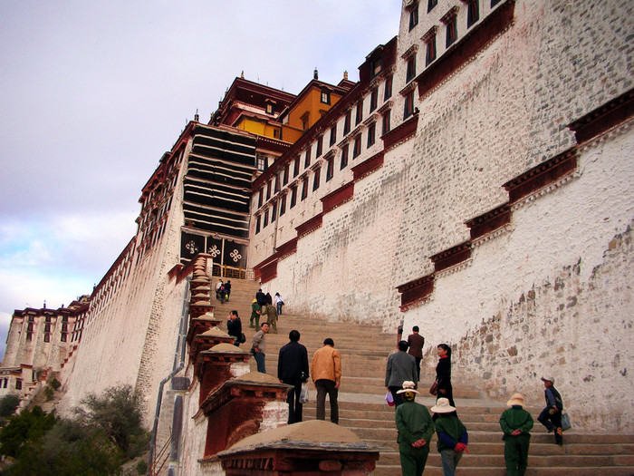 Ascending the steps of the Potala Palace.