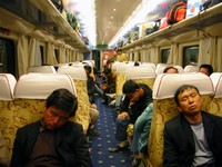 "We boarded the train to Tibet in Golmud at 4:15 am. Most people were still sleeping. Check out the plush upholstery and carpeting... not bad for ""hard seat"", the lowest class on Chinese trains."