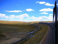 The train to Lhasa passes through Tibetan grasslands.