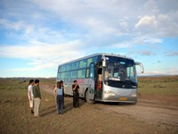 Our sleeper bus pauses for a morning bathroom break (not that there was a bathroom) in the middle of nowhere AKA the Junggar Basin. Lincoln, Xiao David, and Carrie stretch their legs.