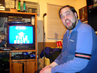 At home with his machines: my friend, Chris Holcomb, the video-game fiend.