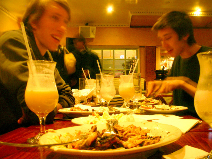 Reunion time! Ben Ransford and Chris Erway, chowing down on some Dominican chicken and drinking Pina Coladas up in Inwood, NYC.