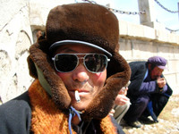 On the way to Qinghai Lake we stopped at some lackluster tourist trap where I snapped a shot of this Tibetan man enjoying a smoke.