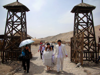 Where the Ming Dynasty Great Wall comes to an abrupt end near Jiayuguan, newlyweds prepares to take wedding photos.