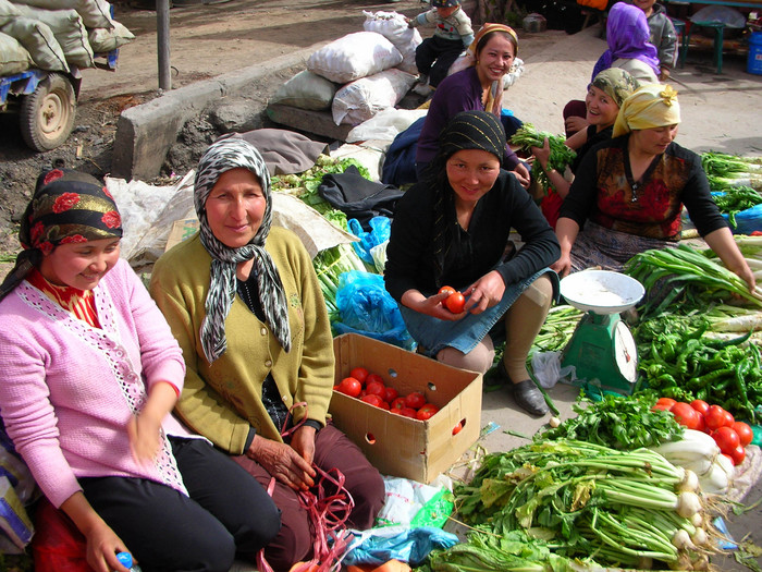 Uyghur women selling vegetables at Kuqa's Friday bazaar.