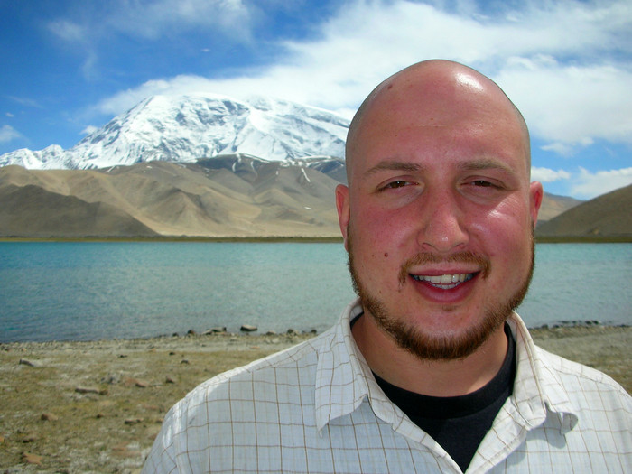Me, at Lake Karakul with Mustagata in the background. Note the bald head and Uyghur-styled facial hair.