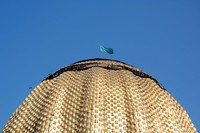 We're not in China anymore! The Kazakh flag flies high in Almaty.