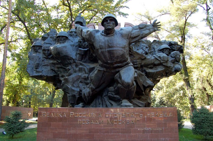 The massive War Memorial (World War II) in Panfilov Park, Almaty. The overall shape of the memorial is a map of the Soviet Union, and the 15 faces represent each one of the Soviet states.