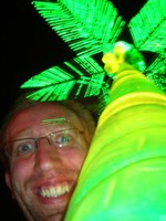 Daniel gets up-close and personal with a psychedelic neon palm!