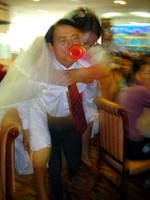 I was invited with Camilla to a Hua Shan teacher's wedding party. Here, the groom is forced to carry the bride on his back around the room while blowing a horn.