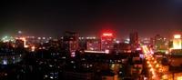 A nightime panorama of Korla's skyline.